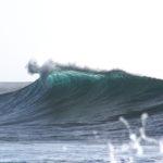 Breaking wave on beach